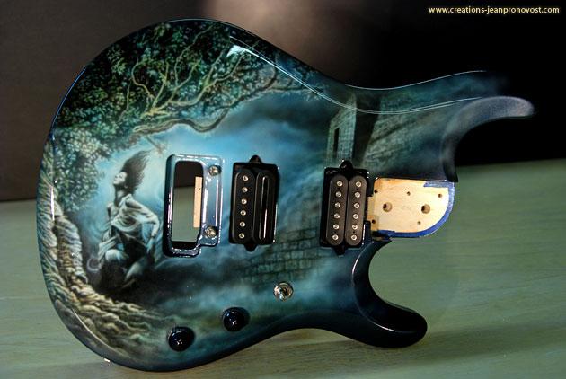 Guitare peinte au airbrush à Montréal