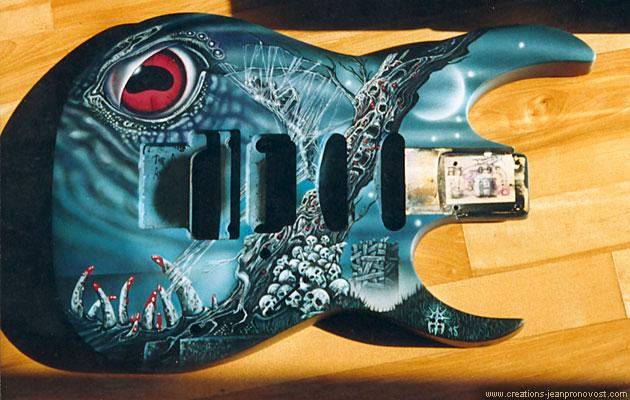 Guitare Obituary peinte au airbrush