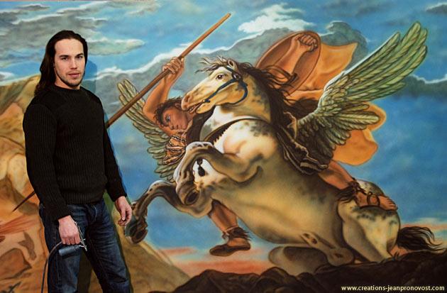 Le peintre Jean Pronovost devant un détail de cette murale faite au airbrush