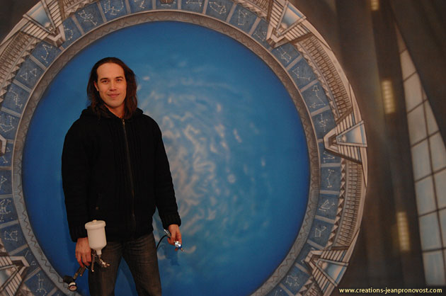 Jean Pronovost in front of the Stargate mural he painted with an airbrush in is workshop in Montreal