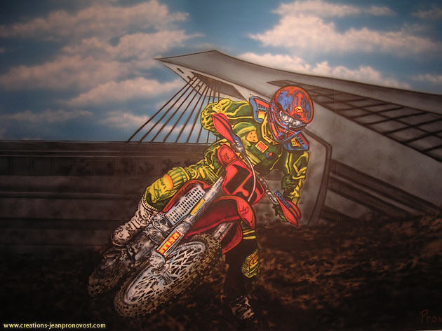 Motocross mural airbrushed on a wall of a child's bedroom