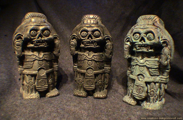 Variety of faux finishes on Xolotl Aztec statuettes