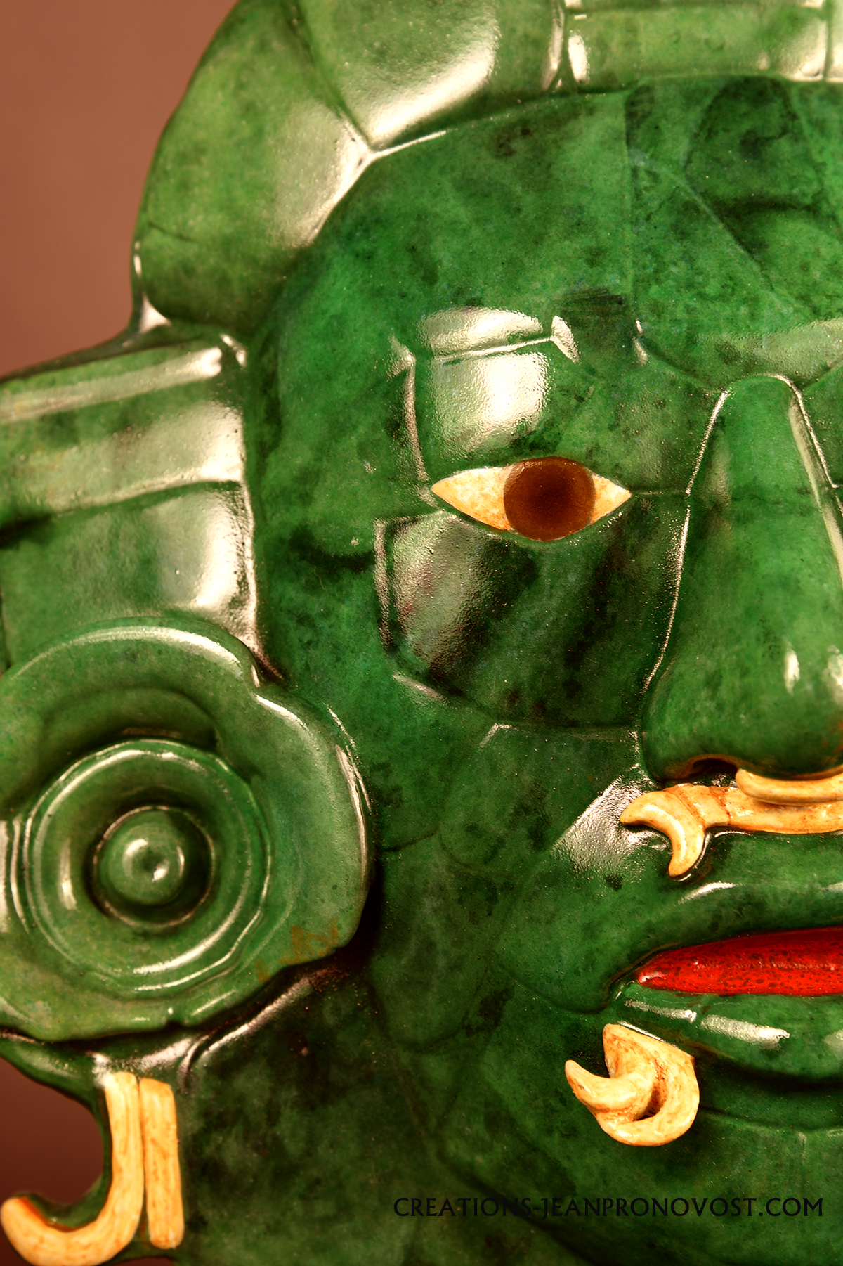 Jade mask sculpture in detail.